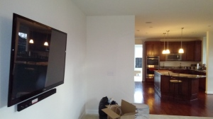 Tv. and sound bar mounted using a tilting wall mount